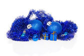 Blue christmas decoration and blue tinsel isolated on white — Stock Photo