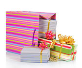 Gift package with christmas boxes isolated on white — Stock Photo