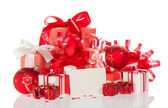 Christmas gifts, toys, a tinsel and blank card — 图库照片