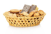 Set of sweet cookies in the wattled basket, isolated on white — Stock Photo