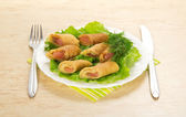 Pancakes with salmon and salad, cutlery, colorful napkin on the table — Stock Photo