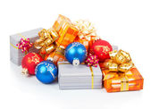 Colorful christmas gifts and blue, red balls isolated on white — Stock Photo