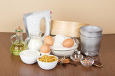 Products and baking dishes of Easter, means for ornament, on the beige — Stock Photo