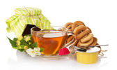 Jam, tea, bagels, raspberry and honey, the flowers — Stock Photo