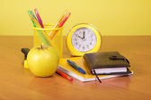 Exercise book, organizer, a support with handles, apple and an alarm clock — Foto Stock