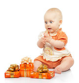 Joyful baby with gifts isolated on white — Stock Photo