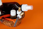 Cosmetics set in a wattled basket, on an orange background — Stock Photo