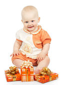 Joy baby with gift boxes isolated on white — Stock Photo