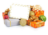 Christmas card with gifts and spheres — Stock Photo