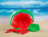 Children's set for game with sand on the seashore — Stock Photo