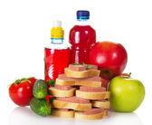 Panini, verdure, mele e bottiglie con la composta — Foto Stock