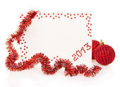 Red card on New Year 2013 with colorful tinsel and red balls isolated on white — Stock Photo