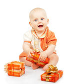Smiling child develops gift box isolated on white — Stock Photo
