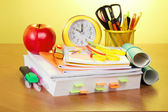 The book, a roll of exercise books, a support with handles, an alarm clock and red apple — Stock Photo
