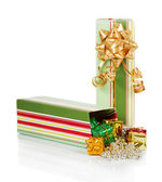 Colorful gift box with christmas tinsel isolated on white — Stock Photo