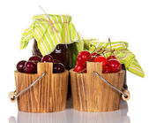 Sweet cherries in buckets, and two banks with the ready jam — Stock Photo