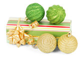 New year's gift box and green, gold balls isolated on white — 图库照片