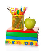 Pile of textbooks, tools in a support and the apple — Stock Photo