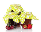 Jam in glass jars, and fresh strawberry and sweet cherries — Stock Photo