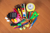 A big set of bright office supply and alarm clock on a table — Photo