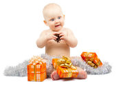 Healthy child holds bump and gift boxes with silver tinsel isolated on white — Stock Photo
