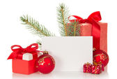 Christmas toys and gifts, fir-tree branch and empty card isolated on white — Stock Photo