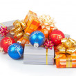 Colorful christmas balls and gifts isolated on white — Stock Photo #32300455