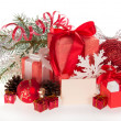 Big and small gift boxes with tapes bows, and Christmas tinsel — Stock Photo #32300589