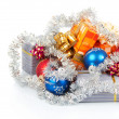 Christmas gifts, balls and tinsel isolated on white — Stock Photo