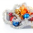 Christmas gifts, balls and tinsel isolated on white — Stock Photo #32300687