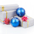 Christmas gifts and blue balls isolated on white — Stock Photo