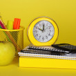 The book, accessories to the letter, the calculator an alarm clock and apple — Stock Photo