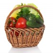 In a wicker basket, cabbage, tomatoes, cucumbers, pepper and the greens — Stock Photo