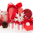 Gift boxes, the Christmas toys, snowflakes and pine cones, isolated on white — Stock Photo