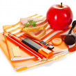 Writing materials, hourglasses, sandwich and apple on the striped napkin — Stock Photo