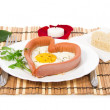 Sausage in the form of heart  on a white plate and bread, red rose isolated on white — Stock Photo