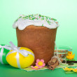 Eggs, Easter cake, sweet jewelry, cinnamon and vanilla, on a green background — Stock Photo