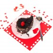 Chocolate cake on a red napkin with hearts isolated on white — Stock Photo
