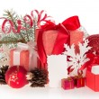 Big and small gift boxes with tapes bows, and Christmas tinsel, isolated on white — Stock Photo