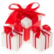 Stock Photo: Red gift box and two white boxes with bright bow, isolated on white