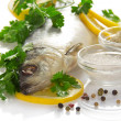 Big herring with a lemon and the spices isolated on white — Stock Photo