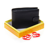 Man's black purse in yellow gift box with two red hearts from a paper tape isolated on white — Foto de Stock