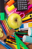 A big set of bright office supply, and an apple, closeup — Stok fotoğraf