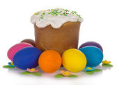 Easter cake, colourful eggs and the sweet jewelry isolated on white — Stock Photo