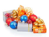 Colorful christmas balls and gifts isolated on white — Stock Photo