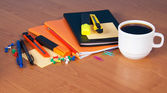 A set of office accessories, the diary, exercise books, blank for notes and a cup of coffee on a table — Stock Photo