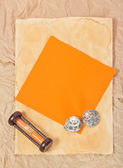 Old paper, two sea cockleshells, hourglasses and orange card — Stock Photo