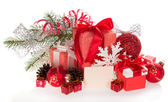 Big and small gift boxes with tapes bows, and Christmas tinsel — Stock Photo