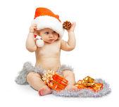 Positivität kind in santa claus redhat hält bump mit silber flitter, bunte festlich, isoliert auf weiss — Stockfoto