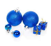 Christmas blue balls and blue gift boxes isolated on white — Stock Photo